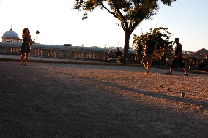 "It's hip to play ""Petanque"" here (a mix of horseshoes and bocce ball?)"